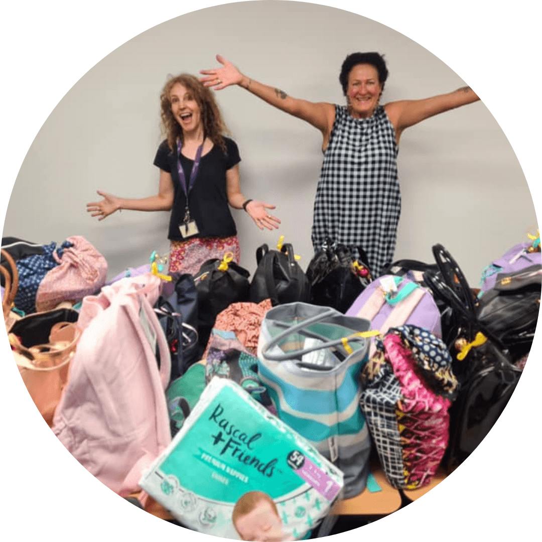 Two Shero volunteers with bags from It's in the Bag